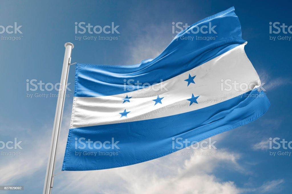 Honduras Flag is Waving Against Blue Sky stock photo