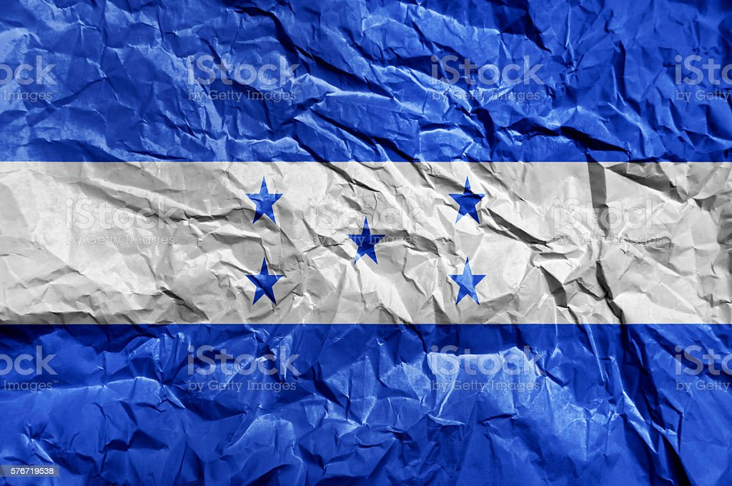 Honduras flag painted on crumpled paper background stock photo