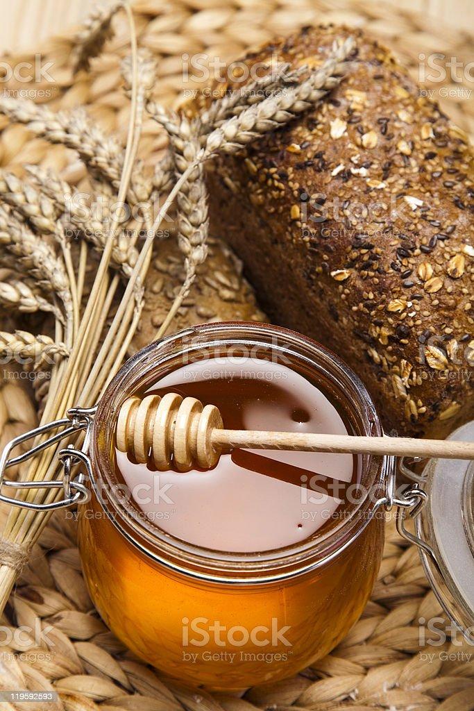 Honey and bread stock photo
