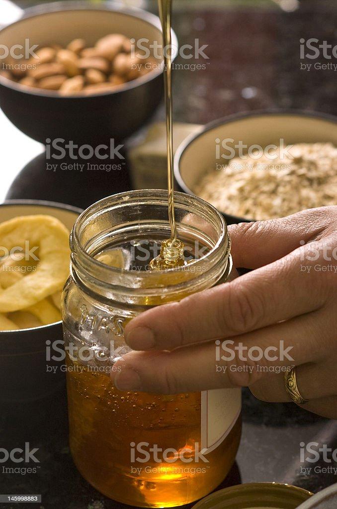 Honey and Hand royalty-free stock photo