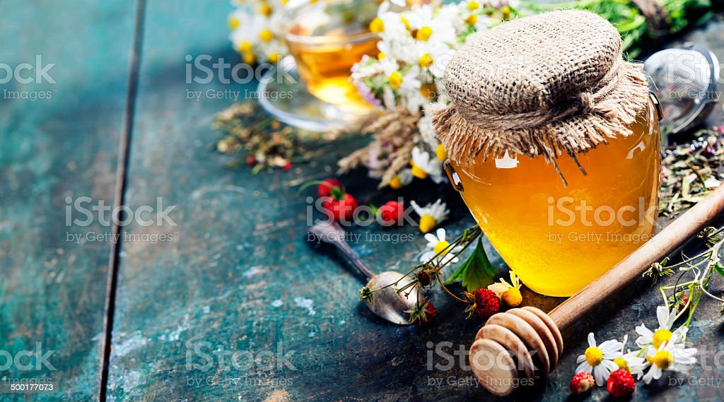 Honey and Herbal tea stock photo