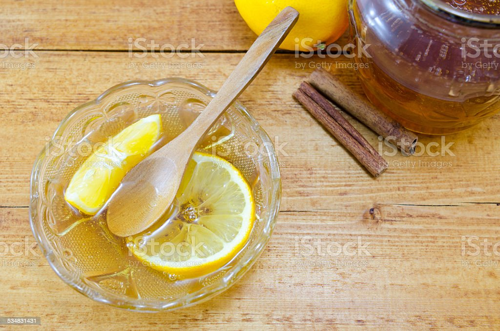 Honey and lemon desserts on a table royalty-free stock photo