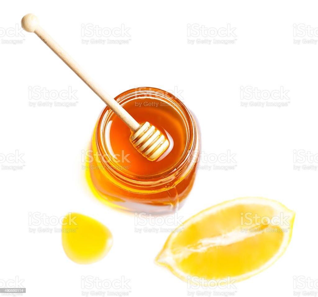 Honey and lemon isolated on a white background. Sweet stock photo