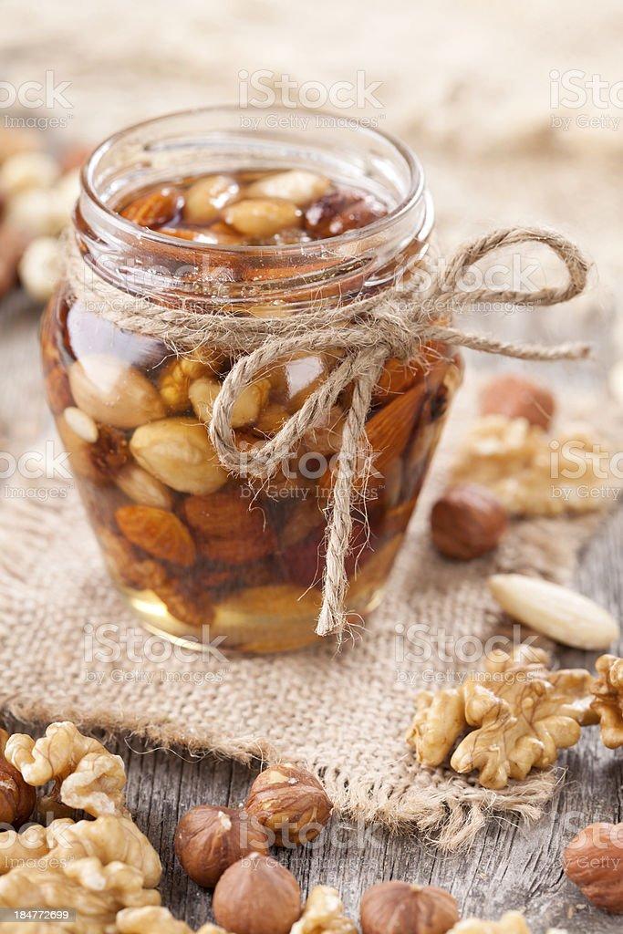 Honey and mixed nuts royalty-free stock photo