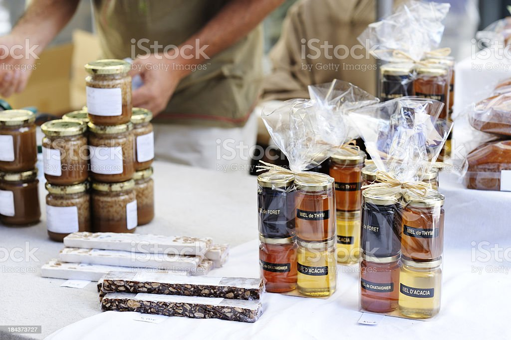 Honey and nougat on French market stall stock photo