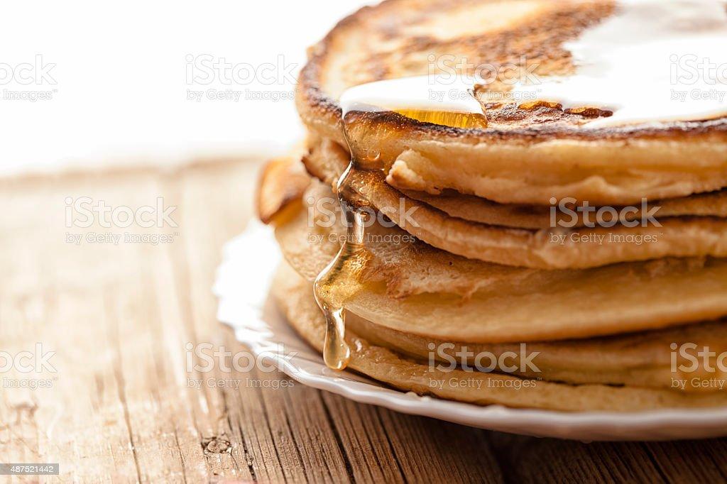 honey  and pancakes stock photo