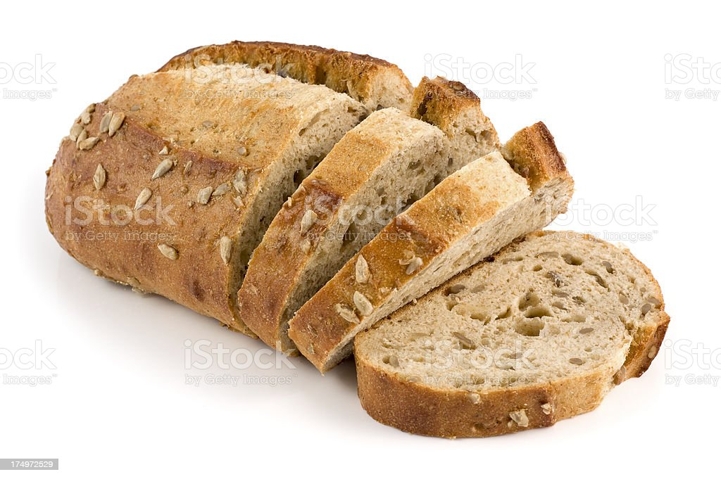 Honey and seed loaf of bread on a white background stock photo