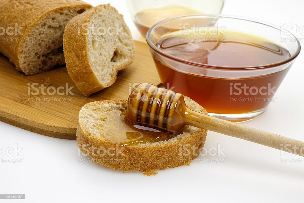 Honey and slices bread stock photo