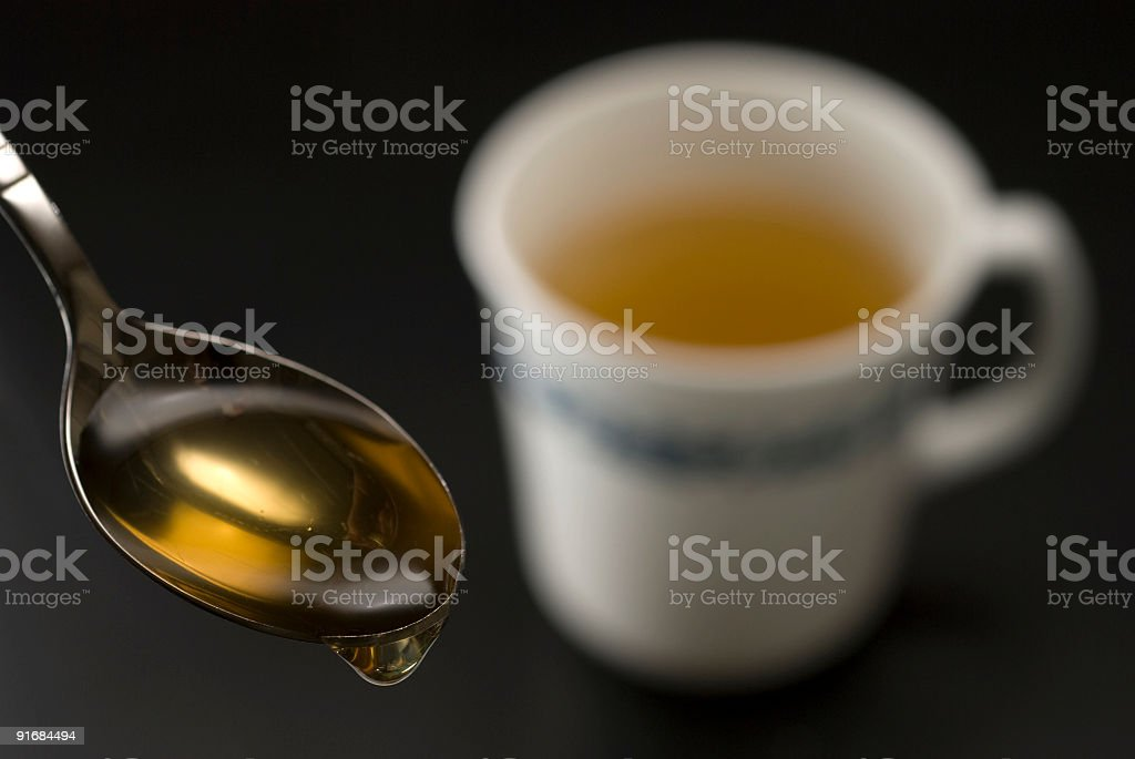 Honey and tea cup royalty-free stock photo