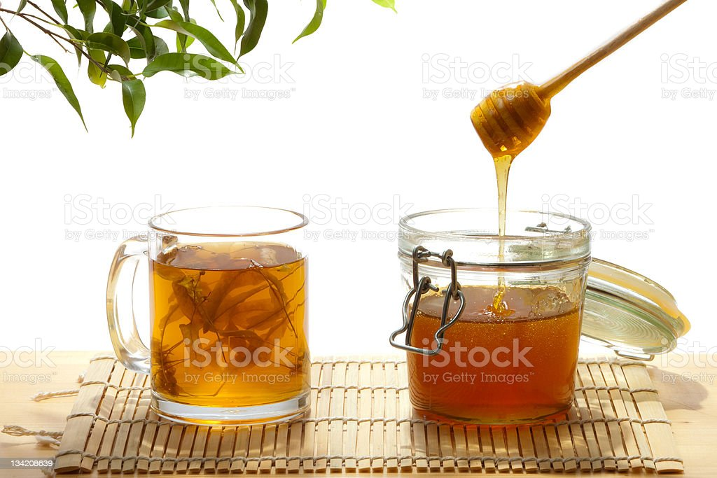 Honey and tea from lime tree stock photo
