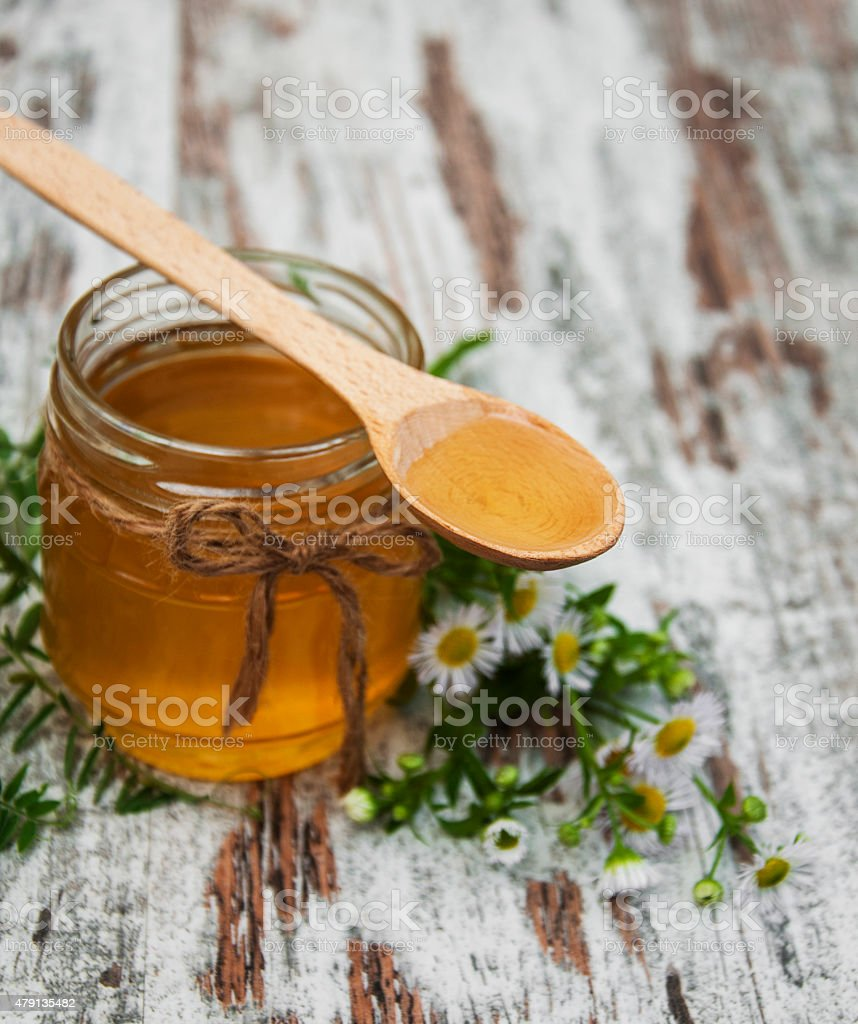 Honey and wild flowers stock photo
