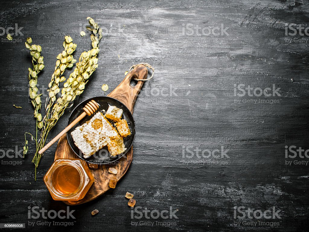 Honey background. Natural  and herbs on a wooden Board. stock photo