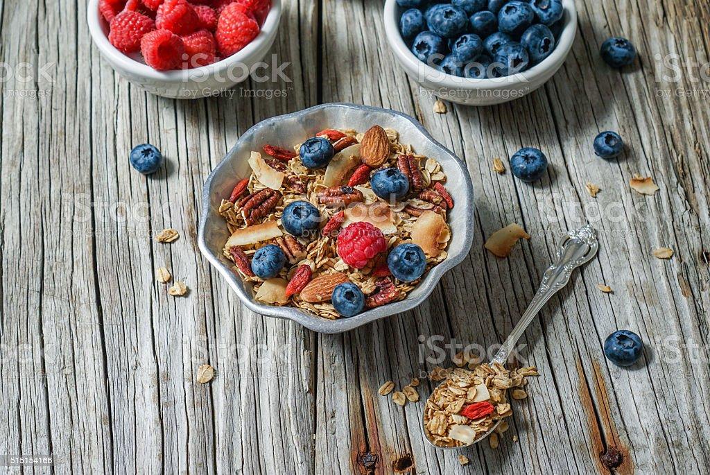 Honey Coconut Granola with Nuts, Berries and Goji Berries stock photo