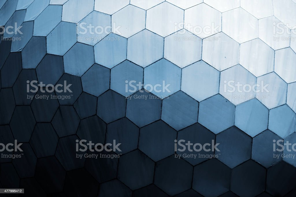 Honey comb shaped geometrical blue toned pattern stock photo