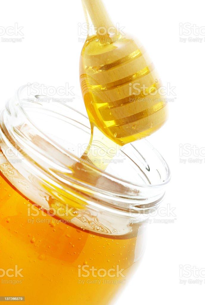 Honey dipper and jar royalty-free stock photo