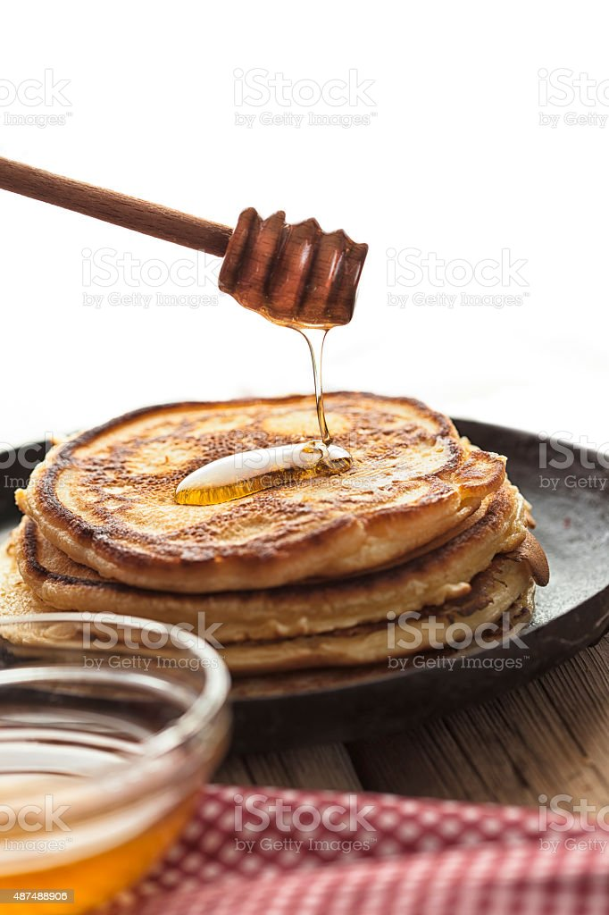 honey dipper and pancakes stock photo