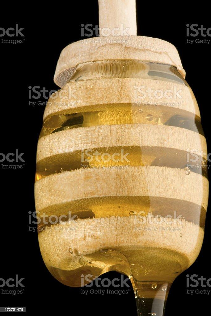 honey dripper stock photo