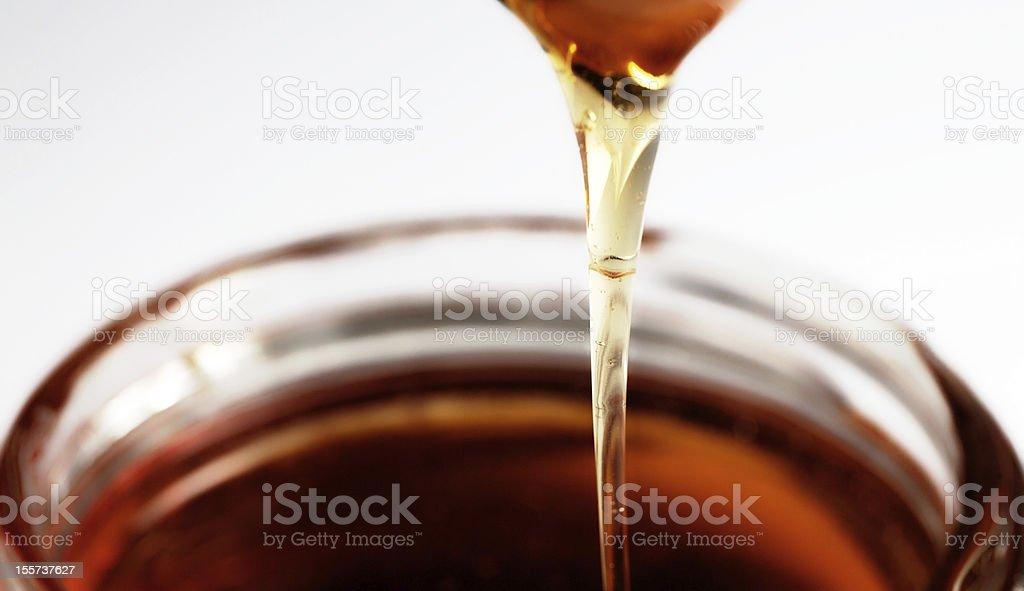 Honey Dripping Into Jar royalty-free stock photo