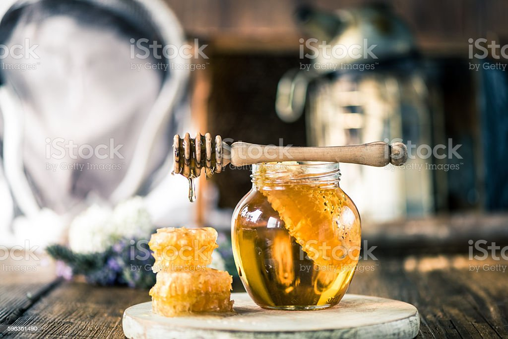 Honey dripping over vax comb stock photo