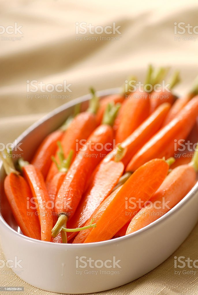 Honey glazed carrots in a serving dish stock photo