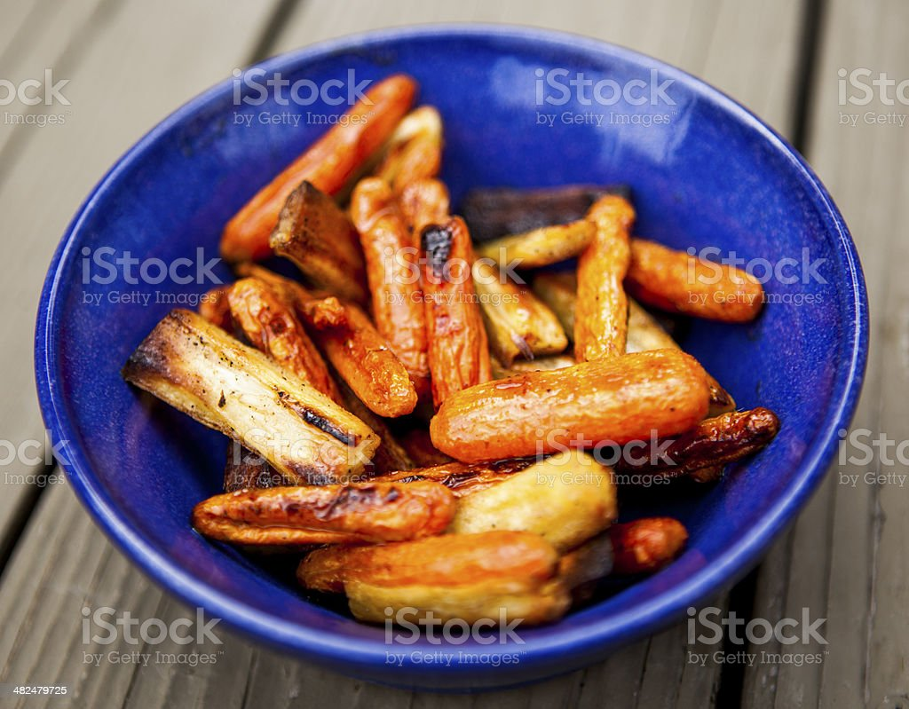 Honey Glazed Roasted Carrots and Parsnips stock photo