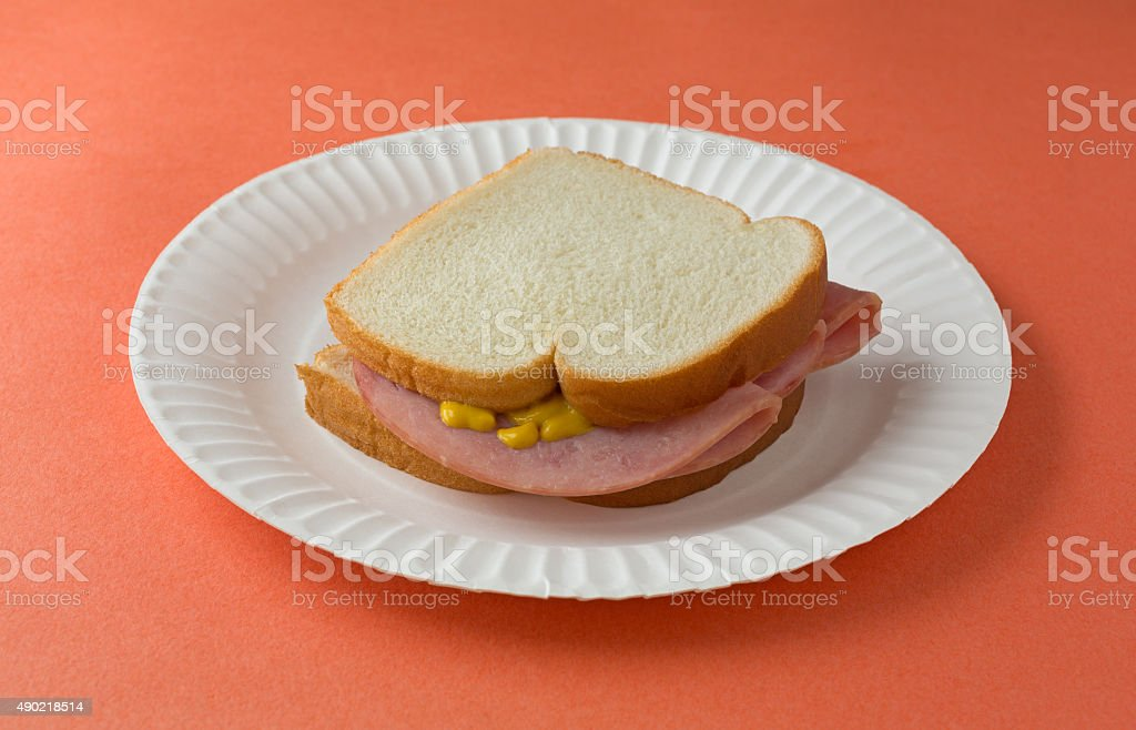Honey ham sandwich on a paper plate stock photo