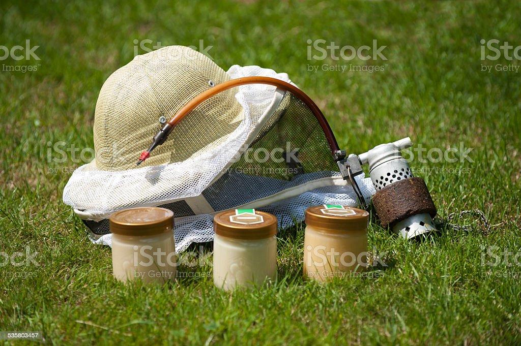 Honey, hat and Smoker beekeepers tool stock photo
