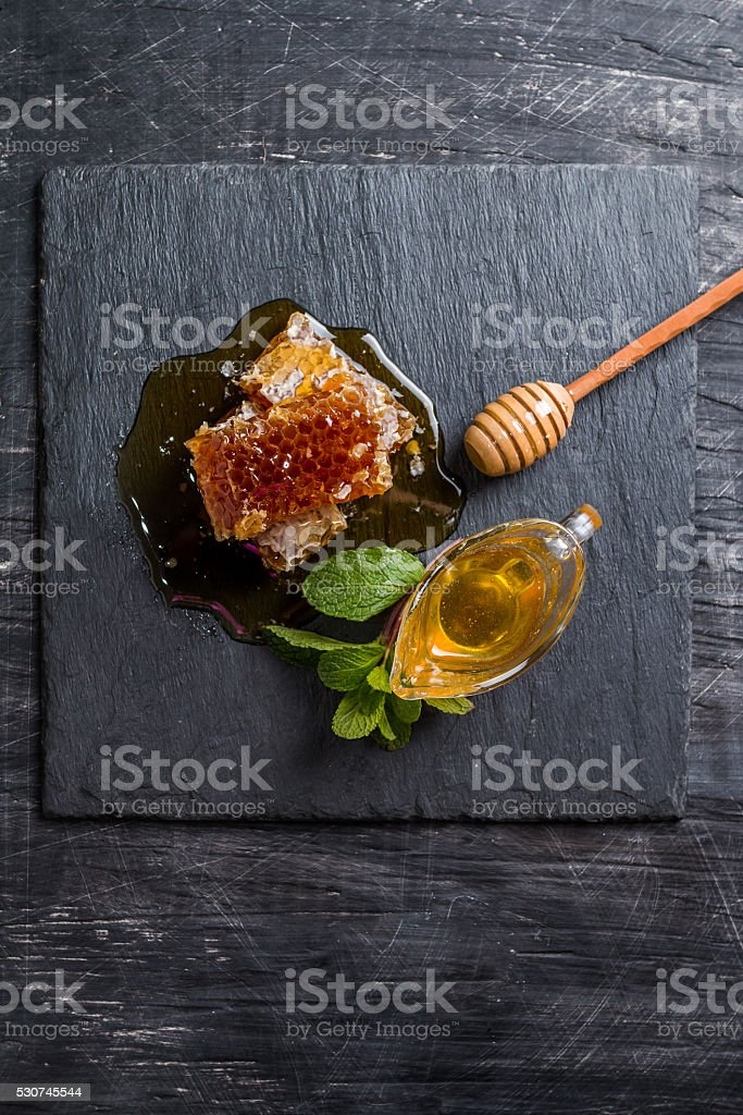 Honey, honeycomb, mint and honey dipper stock photo