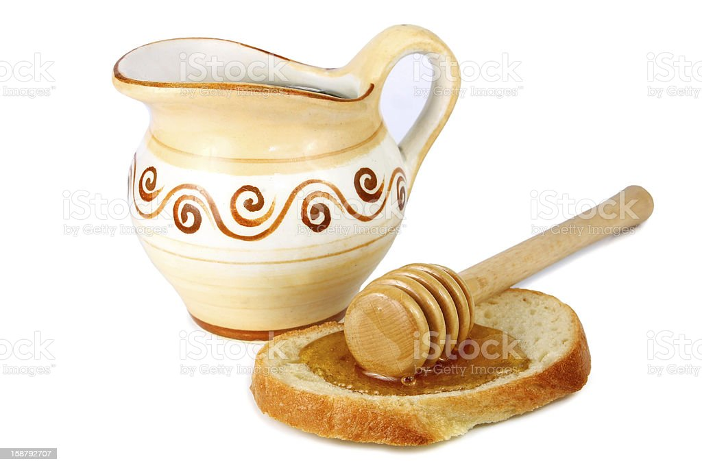 honey in a jug and loaf royalty-free stock photo