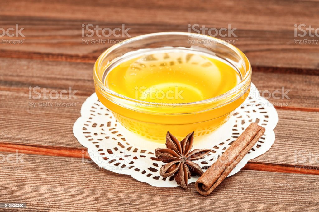 Honey in glass drinking bowl on napkin. stock photo
