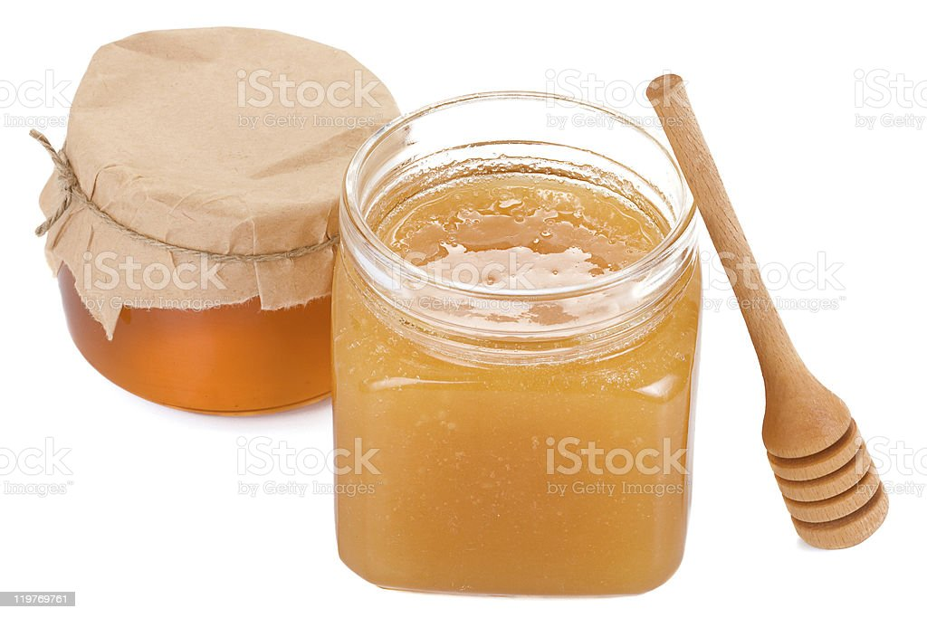 honey in glass jars isolated on white stock photo