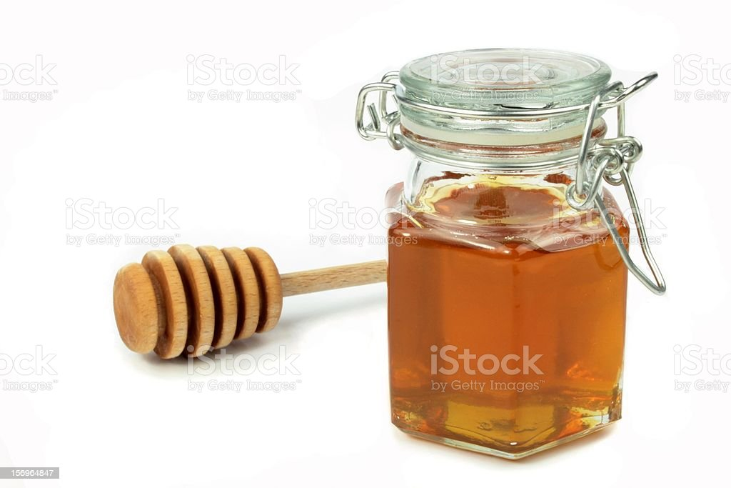 Honey in jar and dipper stock photo