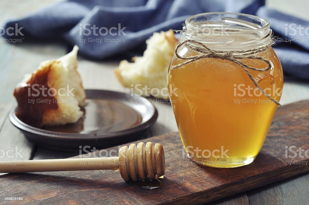 Honey in jar with dipper stock photo