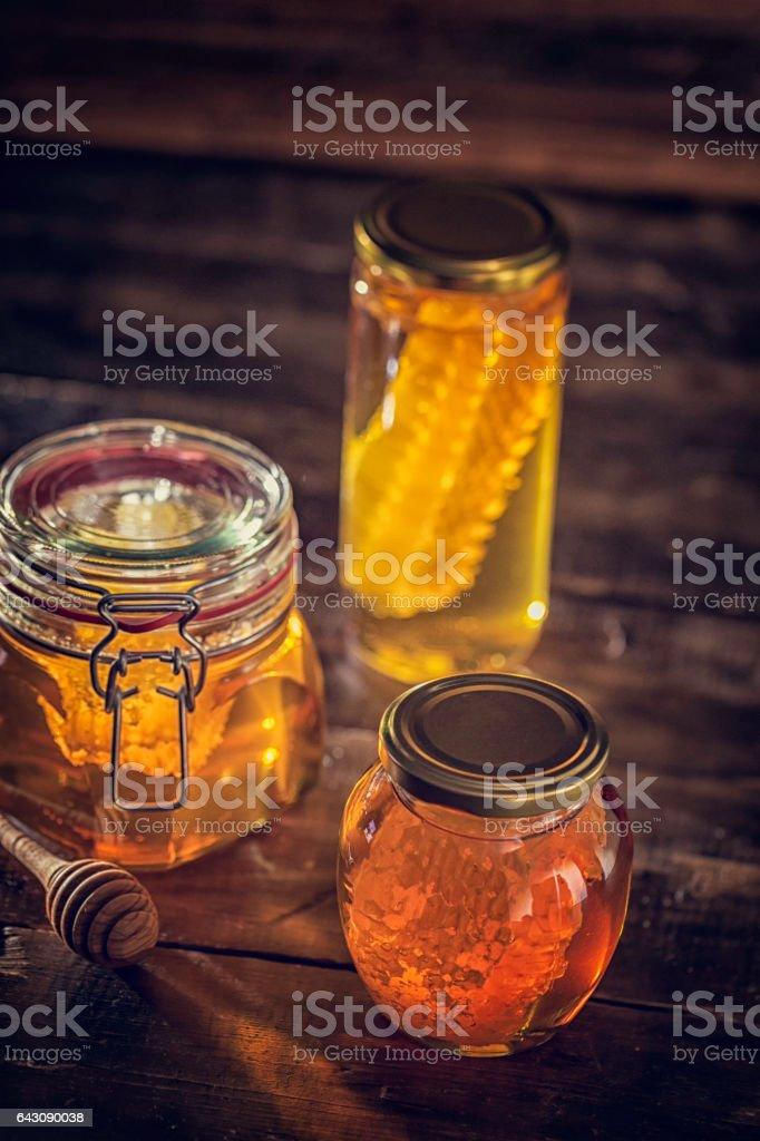 Honey in Jar with Honeycomb stock photo