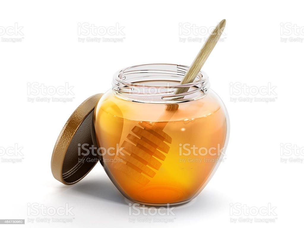 Honey jar and stick inside honey stock photo