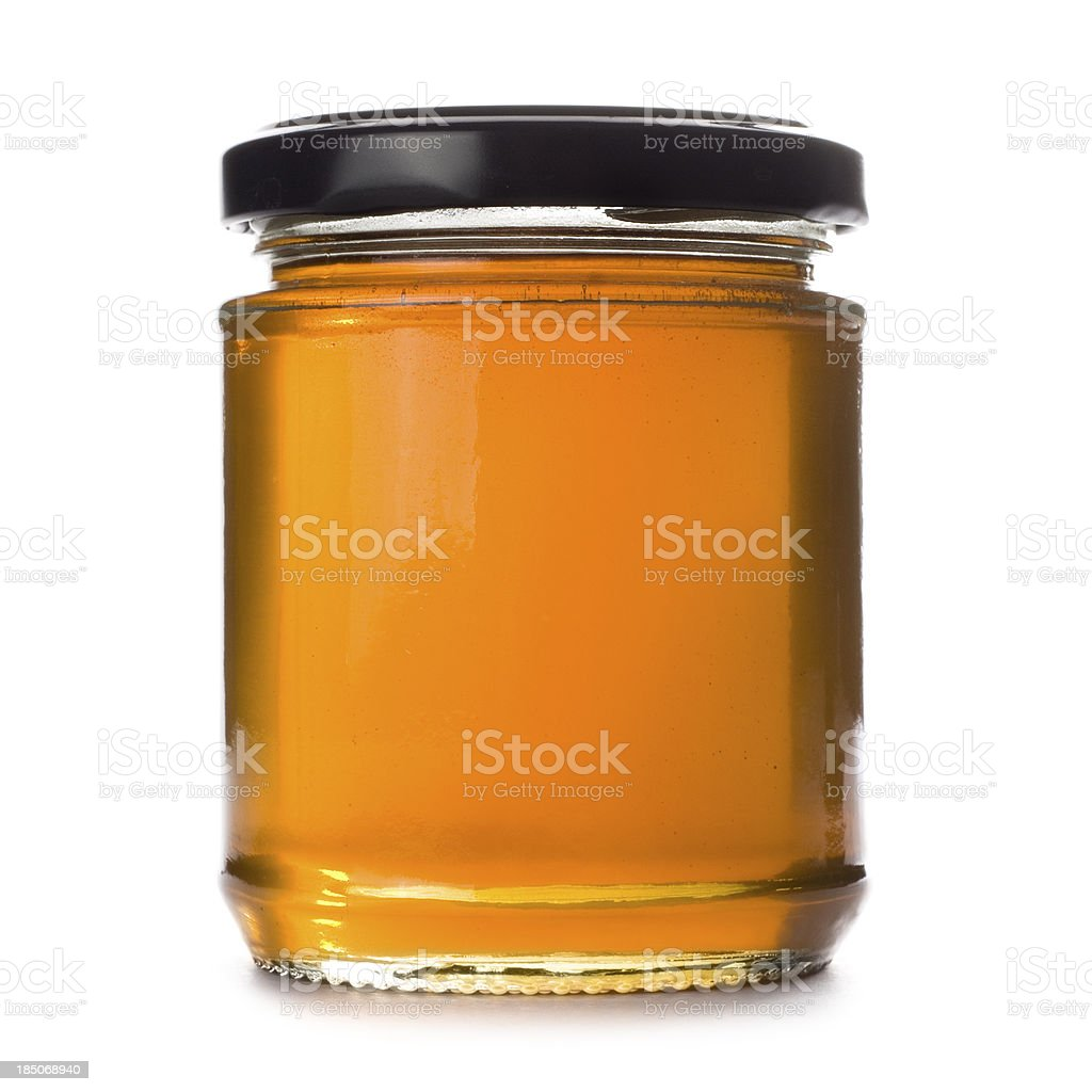 Honey jar on a white background stock photo