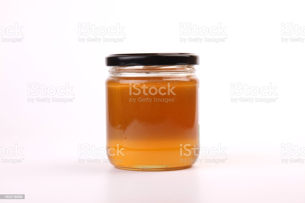 Honey Jar on white background royalty-free stock photo