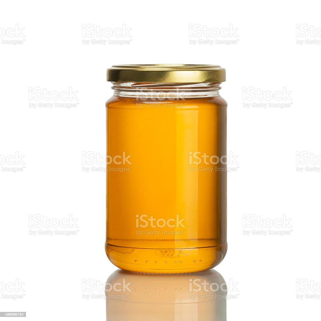 honey jar on white background stock photo