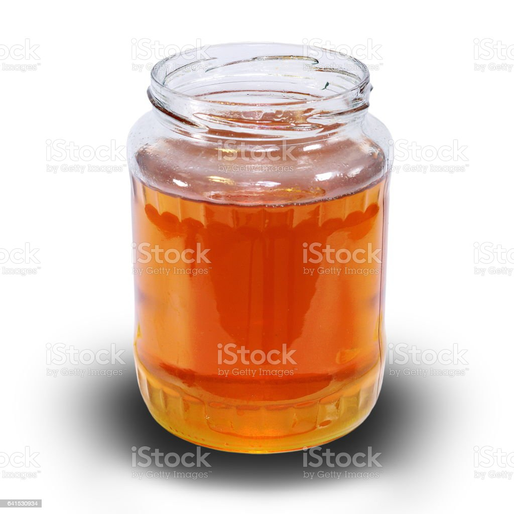 honey jar over white with shadow stock photo