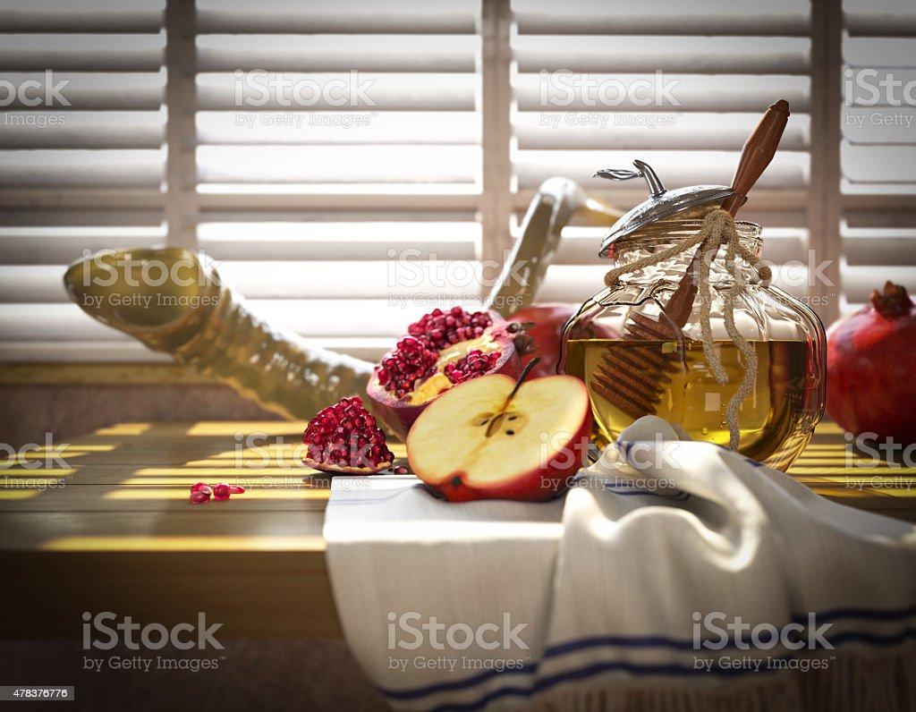 Honey jar with apples and pomegranate for  Rosh Hashana holiday stock photo