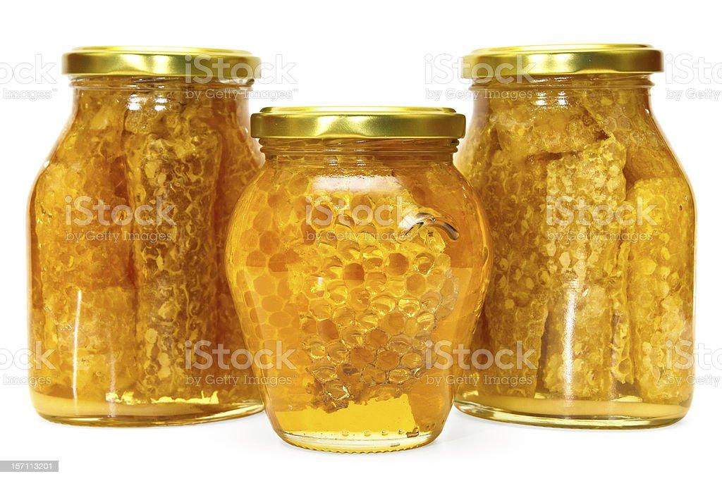 Honey jars isolated royalty-free stock photo