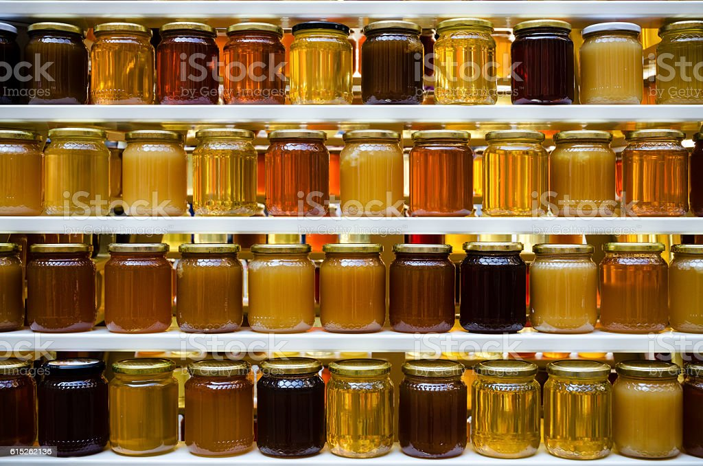 honey jars on a shelf stock photo