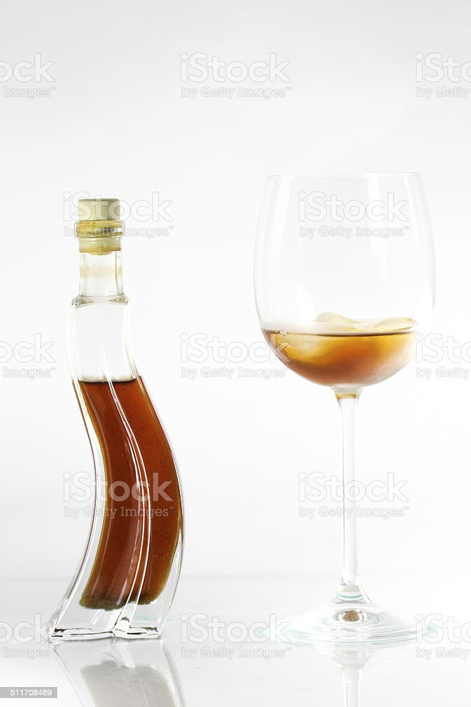 Honey liqueur in a glass with bottle stock photo