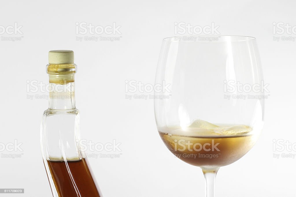 Honey liqueur in glass stock photo