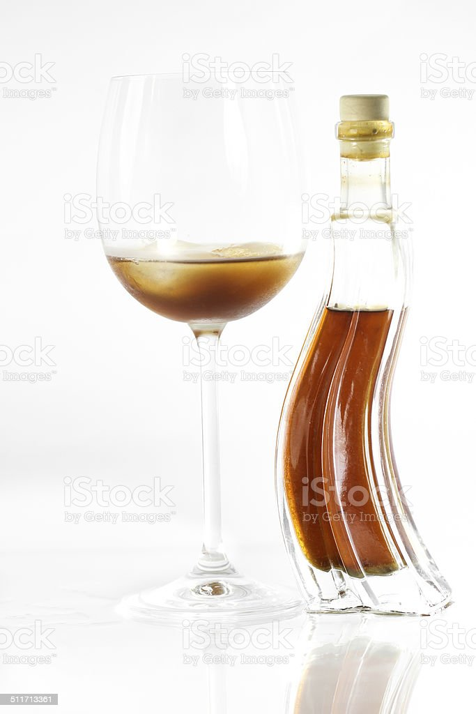 Honey liqueur in wine glass stock photo