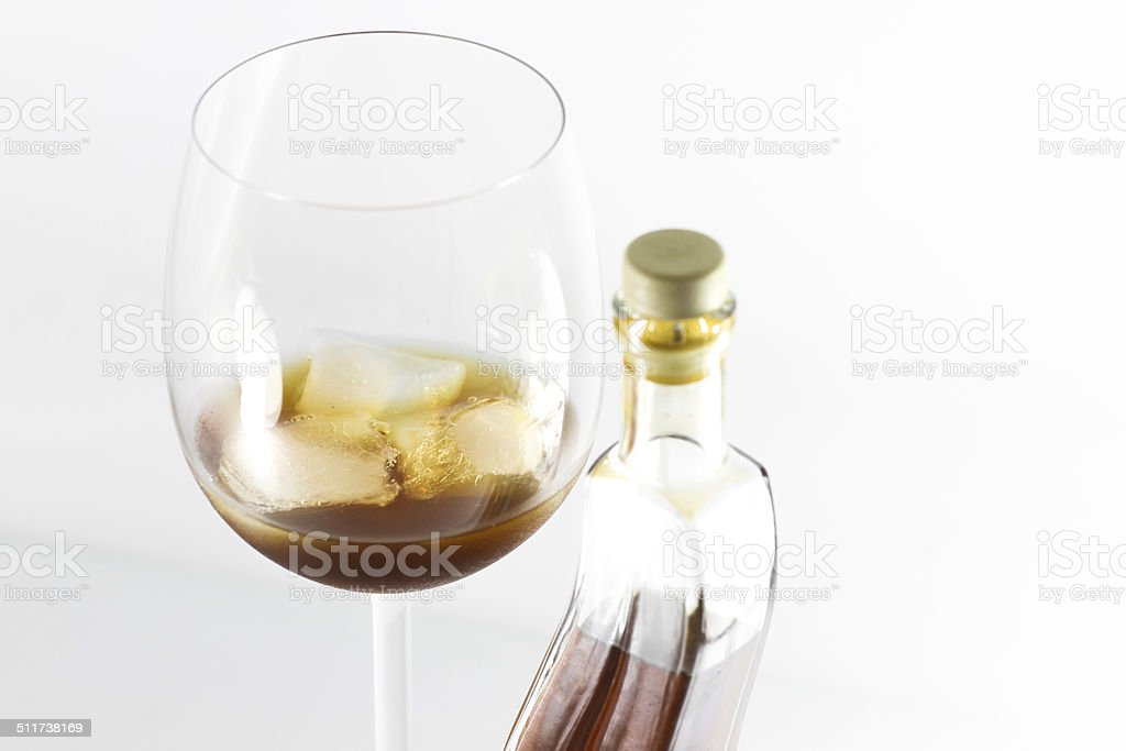 Honey liqueur with ice stock photo