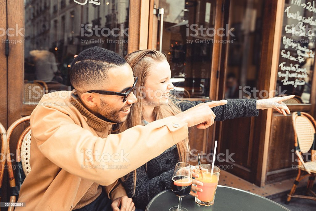 Honey, look what I found! Friends at a cafe. stock photo