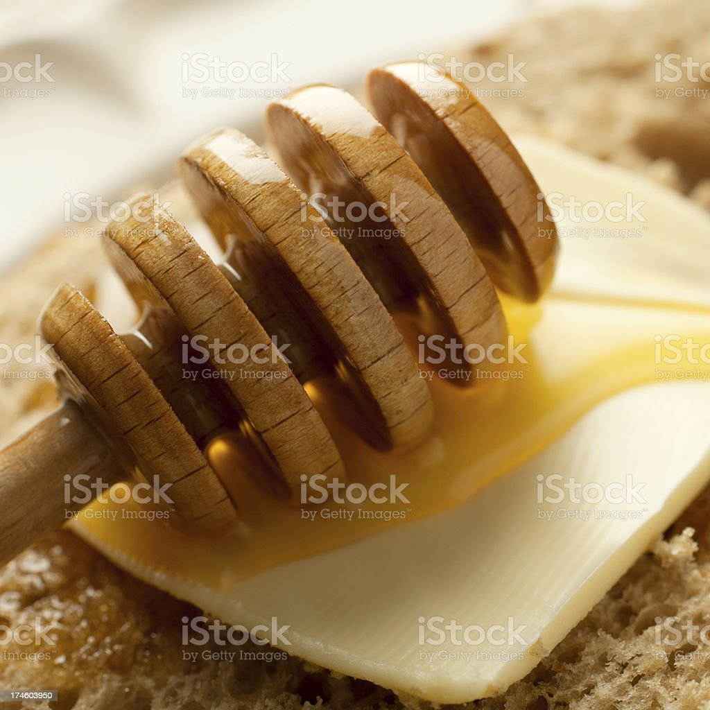 Honey on Butter and Bread royalty-free stock photo