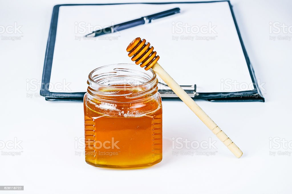 Honey on doctor's table stock photo