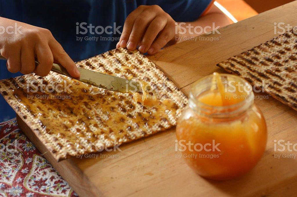 Honey on Matzo bread during Passover Jewh holiday stock photo